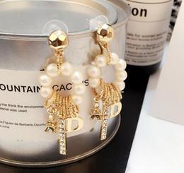 Argentina Corea moda cristal perla borla cuelga los pendientes de gota diseño de letras Eardrop 14 K pendientes de oro para mujer niña joyería del banquete de boda Suministro