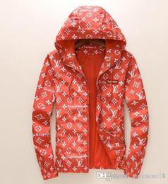 Abrigo de mapache de lujo parkas online-2018 Hot Jackets Luxury Mon Brand Long Down Chaquetas Mujeres abajo Escudo engrosamiento Real Raccoon Fur Collar Hood Parkas