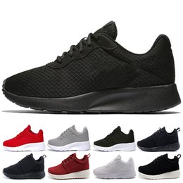 online retailer 09f57 bc7ec Venta al por mayor Run Shoes tanjun negro blanco Red blue Sneakers Hombres  Mujeres Deportes zapatillas London Olympic Runs Shoes Jogging entrenador  tamaño ...