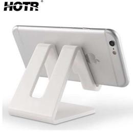 Soportes de plástico para tabletas online-HOTR Universal Desk Holder Tablet Soporte para teléfono móvil con almohadilla de silicona a prueba de golpes Fuerte Soporte de teléfono celular de plástico Soporte de montaje