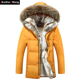 2882273495a4a Winter jacket men high quality Men s long down coat Fashion big hair collar  Thicker warmth Hooded leisure park jacket 4XL 5XL Y181101
