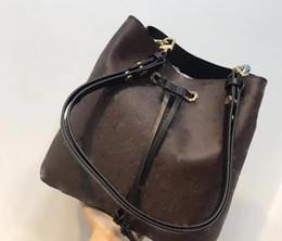 Bolsos de cuero cubo online-2019 Moda bolso de cubo de cuero genuino de las mujeres famosas bolsos con cordón de impresión de flores bolso crossbody