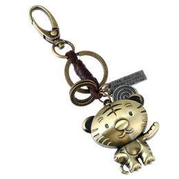 Cadeia de ox on-line-12 zodíaco boi chaveiro de couro liga de metal tigre pingente de presente criativo de couro tecido chaveiro homens jóias