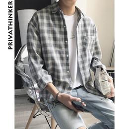 Camisa de cuadros a cuadros de manga larga para hombres y mujeres Camisas de manga para a rayas de franela casual para hombres camisas de otoño hawaianas M-2XL desde fabricantes