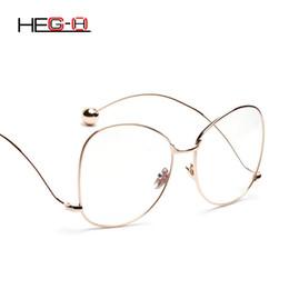 HEG-H Mujeres Marco de Anteojos Gafas de Lente Clara Curva Gafas Pierna  Gafas de Aleación de Alta Calidad Marco Diseñador de la marca de diseño H083 d86f06dd752f