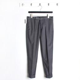 Nuevo estilo TB estilo británico otoño e invierno, cinta clásica, cintura baja, nueve puntos, pantalones para hombre desde fabricantes