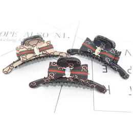 Porta cola online-Classic Red Green Striped Bowknot Claw Hair Clips 3 colores acrílico letras G abrazaderas para el cabello mujeres chica cola de caballo tail holder accesorios