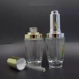 Prensa de aceite esencial online-20ml 30ml Botella de vidrio transparente con oro plata Prensa cuentagotas Botellas de aceite esencial Contenedor de vidrio cuentagotas cosmético