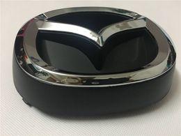 Kühlerhalter online-Kühlergrill-Emblem für die vordere Stoßstange für Mazda CX5 2015-2016 KE KA5C-51-731 Abzeichenhalter KA5C-51-721 Maskottchenlogo