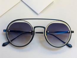 Nueva moda de lujo para mujer diseñador gafas de sol con marco de metal  redondo 118 gafas redondas para hombres uv400 gafas de tendencia de alta  calidad 19e6091b8cab