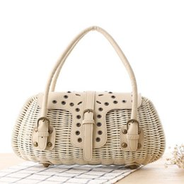 Wholesale Rivet Brass - New personality brass buckle rattan bag knit Japanese rivets button hand carry knit handbags travel holiday beach bag