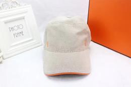 En gros de haute qualité toile tissu chapeau de soleil tourisme sports de plein air casquettes de baseball casquette de baseball de marque marque des chapeaux populaires européens avec boîte ? partir de fabricateur