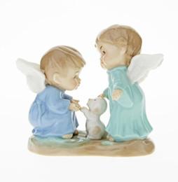 Ángeles cerámicos online-Creativo de cerámica niños lindos niño bebé perro ángel estatua decoración para el hogar artesanías decoración de la habitación artesanía estatuilla decoración de la boda