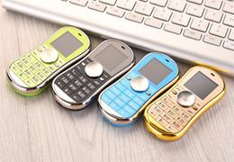 2017 горячие продажи черный непоседа Spinner мобильный телефон 1.3 дюймов двойной SIM-карты Bluetooth ручной Spinner мобильный телефон Рождественский подарок партия выступает за детей от Поставщики продажа сим-карт