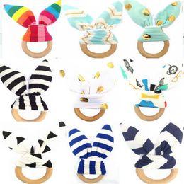 31 Cores brinquedos do bebê Recém-nascido mordedor de madeira natural círculo de madeira chocalho tecido bebê chocalhos brinquedos do bebê brinquedos dentição anel de treinamento para o bebê cheap baby ring rattles de Fornecedores de chocalhos de anel de bebê