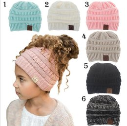 Wholesale knitted military hats - Kids CC Beanies Messy Bun Beanie Kids CC Ponytail Beanie Children Soft Cable Knit Messy High Bun CC Beanie Hat CNY305