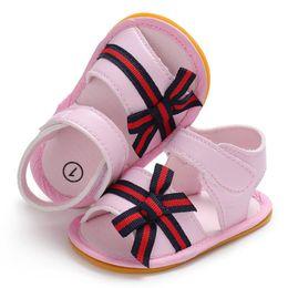 Argentina Moda de cuero de LA PU primeros caminantes bebés recién nacidos princesa princesa arco pelado niños suela de goma al aire libre zapatos infantiles cheap stripped rubber shoes Suministro