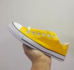 Обувь по цене онлайн-Цена завод акционной цене!femininas холст обувь женщины и мужчины, высокий низкий Стиль Классический холст обувь кроссовки холст обувь