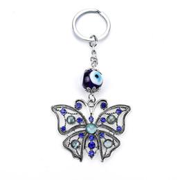 Wholesale Led Solar Butterfly Lights - 2017 new lucky eye explosion Glass Eye Pendant butterfly animal key buckle