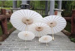 2018 Braut Hochzeitssonnenschirme Weißpapierregenschirme Chinesischer Minihandwerkregenschirm 4 Durchmesser: 20,30,40,60cm Hochzeitsregenschirme für Großverkauf von Fabrikanten