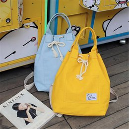 f92e1654ed8e Canvas Backpack Female Drawstring Shoulder SchoolBags For Girls Teenage  Rucksack Women Printing Dual Bucket Bag Handle