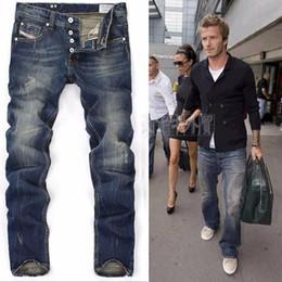 Hip hop homens calça jeans on-line-Motociclista masculino rasgado skinny designer rock revival calça jeans verdadeira para hip hop moda azul vintage mão-esfregou algodão calças retas
