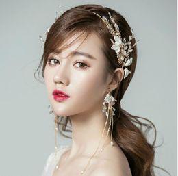 Joyería nupcial, cuentas de mano, flores, artículos de sombrerería dorados, juegos de aro, accesorios de boda, corona, accesorios para el cabello de Corea. desde fabricantes