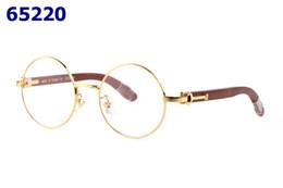 Luxo Rodada Armações de Óculos Para Homens Óculos De Madeira De Metal  Moldura Óptica Mulheres Moda Retro Full Rim Olho Óculos Espetáculo à venda  bordas ... 5d150389d1