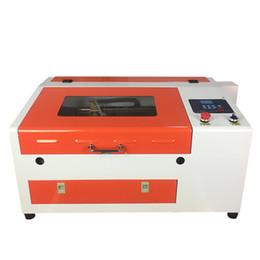 Argentina Portátil mini láser grabado 50 W máquina láser CO2 grabado de vidrio escritorio CNC 3040 máquina láser Precio barato con mesa elevadora eléctrica Suministro