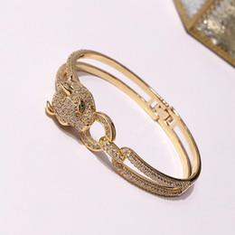 Diamantes de dinero online-Comercio al por mayor de joyería de leopardo caliente al por mayor brazaletes de leopardo de dinero de estilo europeo y americano pulsera de diamante de alambre doble