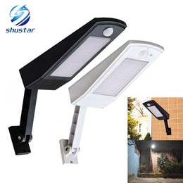 Wholesale led lighting for outdoors - Newest 900lm Led Solar Light Outdoor Waterproof Lighting For Garden Wall 48 leds Four Modes Rotable Pole Solar Lamp