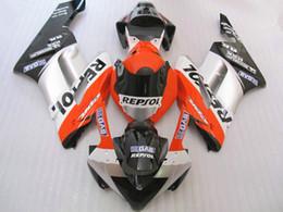 Los carenados de alta calidad para Honda CBR1000RR 2004 2005 naranja kit blanco negro de inyección de moldes carenado CBR 1000 RR 04 05 YY56 desde fabricantes