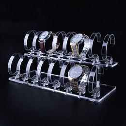 Schaufensterzähler online-Multi-Uhr-Ausstellungsstand klares Acryl mit elastischem C-Ring-Clip Boutique-Theken-Schaukasten-Kiosk-Armbanduhr-Organisator-Ausstellungs-Prop