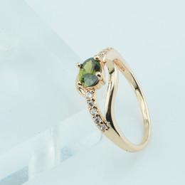 2019 pedras verdes azeitonas FJ Mulheres Jóias Olive Green Stone Anéis 585 Cor De Ouro Zircão Cúbico Anéis De Casamento Novo pedras verdes azeitonas barato