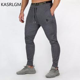 2019 pantaloni stretti di esercitazione 2017 pantaloni fitness da uomo casual in cotone elasticizzato esercizio fitness da uomo collant ricamati, pantaloni sportivi da jogging pantaloni stretti di esercitazione economici