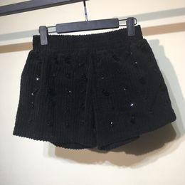 Nuevos pantalones cortos de pana online-Mujeres lentejuelas rebordear Corduroy pantalones cortos 2018 nueva cintura elástica suelta brillante bolsillo dama femme mujer moda carácter desgaste inferior