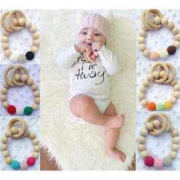 Argentina Nueva Llegada de Estilo Europeo Niños Pulseras de Madera Bebé Mordedor Bebé Cuentas De Madera Mordedores Perlas de La Fabricación de La Dentición Del Bebé Juguetes Suministro