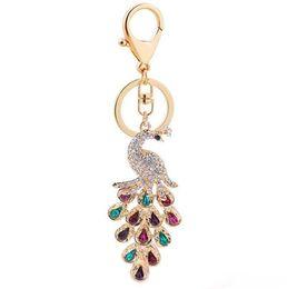 Glückliche ringe online-New Crystal Peacock Keychain Schlüsselanhänger Damen Taschen Anhänger Accessoires Autoschmuck Happy New Year Geschenk