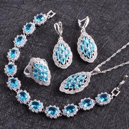 2019 anéis de casamento jade azul Zircão azul 925 Conjuntos de Jóias de Prata Mulheres Brincos Com Pedras PingenteAnéis de Colar Pulseiras Conjunto de Jóias Caixa Gfit desconto anéis de casamento jade azul