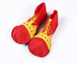 Scarpe cosplay libere online-Le scarpe del pagliaccio di colore di contrasto delle scarpe del pagliaccio divertente degli accessori delle donne degli uomini esegue le scarpe di cosplay di Halloween dei puntelli Trasporto libero