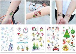Tatuagem para o natal on-line-Arte Corporal Tatuagem Temporária Adesivos de Natal Dos Desenhos Animados Adesivos À Prova D 'Água Papai Noel DIY Etiqueta Da Arte Feliz Natal