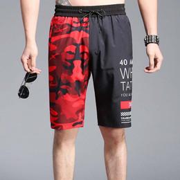 Diseñador hombre pantalones cortos 2018 verano High Street Hip Hop estilo  pantalones Patchwork Camo alta calidad moda ropa deportiva estilos del hip  hop del ... 5326d87b8a2