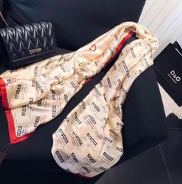 Calavera de tela de seda online-2018 summer beach bufanda de viaje mujeres mantón geometría imitación tela de seda sombrillas borlas de gran tamaño cráneo chales para las mujeres