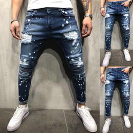 тощие джинсы для мужчин Скидка Новые Мужчины Мода Дизайн Пятно Краска Джинсы Тощий Slim Fit Эластичные Рваные Усы Эффект Джинсы Джинсовые Брюки Стиль Streewear