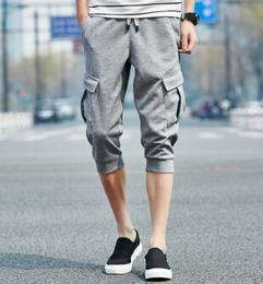 Erkekler Spor Kapriler Pantolon Yaz Harem Şort Atletik Cepler Şort Genç Erkek Genç Giyim Ücretsiz Kargo cheap short capris for men nereden erkekler için kısa kapris tedarikçiler