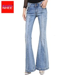 le ragazze tagliano i jeans lunghi Sconti KOZONHEE Stretching Flare Jeans Donna Long Stretching Bell-Bottoms Jeans For Girls Pantaloni per donna Large Size