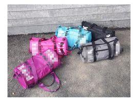 Wholesale Nylon Gym Shorts - New short-distance travel bag, large capacity gym bag hand bill of lading shoulder waterproof duffel bag.