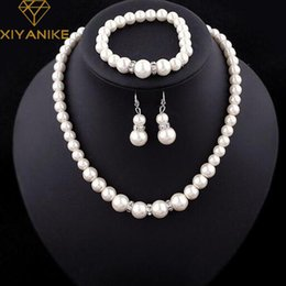 Wholesale Classic Costume Jewelry Wholesale - whole saleFashion Classic Imitation Pearl Silver Plated Clear Crystal Top Elegant Party Gift Fashion Costume Pearl Jewelry Sets N85