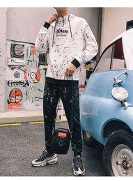 fc22a9aa01d14 2018 Sonbahar Erkekler Eşofman Siyah Beyaz Harfler Nakış Moda Kazak  Beraberlik Dize Gevşek Joggers 2 adet GYM Suits supplier suit drawing