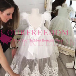 Wholesale low back bow wedding dress - 2018 White Backless Flower Girls Dresses Feather Lace Appliques Hi Low Puffy Tulle Back Cover Bow First Communion Dresses Custom Made